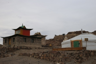 In true Buddhist tradition, there is a stupa in the back of the temple